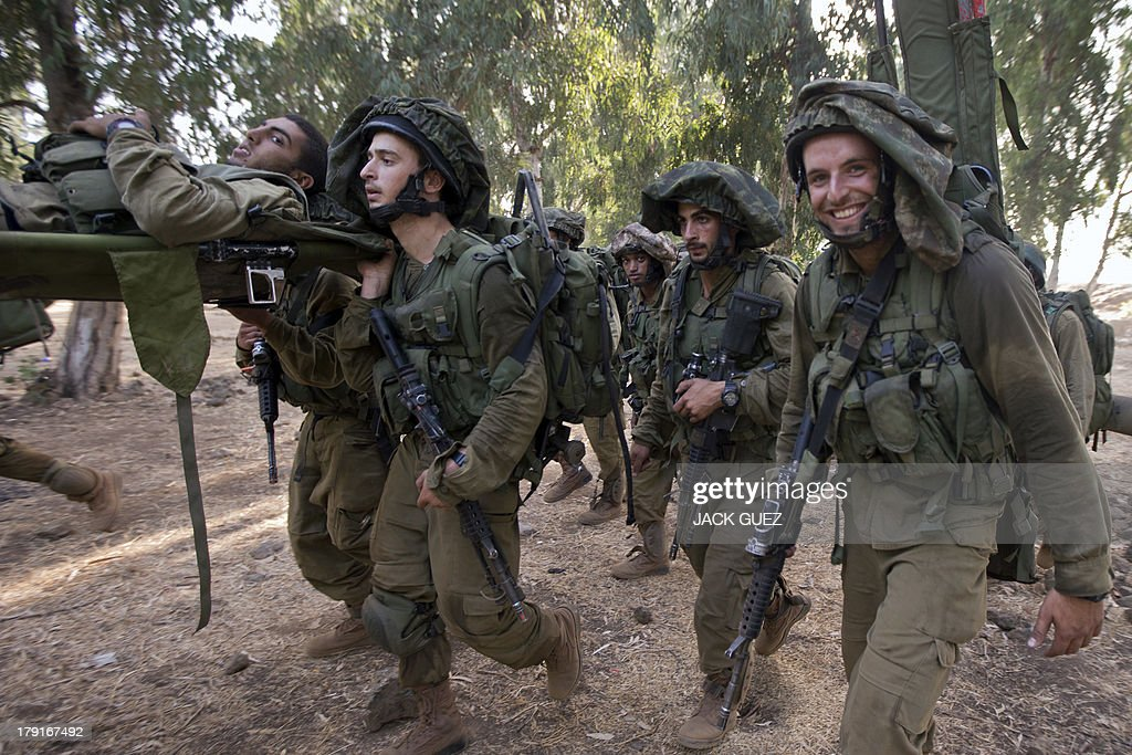 Israeli soldiers from the Golani Brigade take part in a military training exercise in the Israeli-annexed Golan Heights near the border with Syria on September 1, 2013. The Israeli cabinet authorised on August 28 a partial call-up of army reservists amid growing expectations of a foreign military strike on neighbouring Syria, army radio reported. The unspecified number of troops are attached to units stationed in the north of the country, which borders both Lebanon and the Golan Heights.