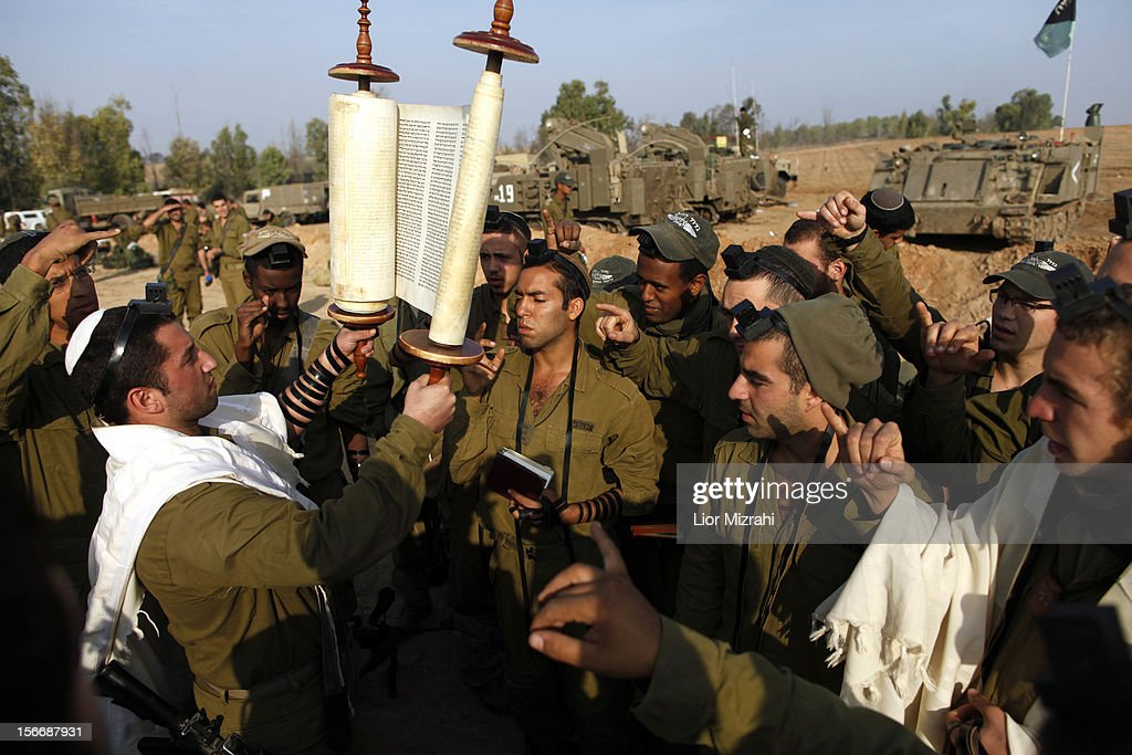 Israeli soldiers gather for morning prayers in a deployment area on November 19 2012 on Israel's border with the Gaza Strip The death toll has risen...