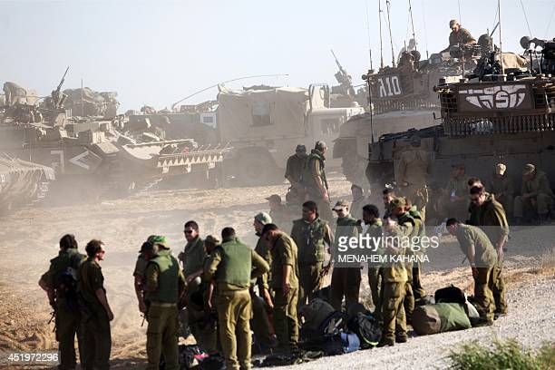 Israeli soldiers gather in an army deployment area near Israel's border with the Gaza Strip on July 10 2014 Gaza militants fired four rockets at...