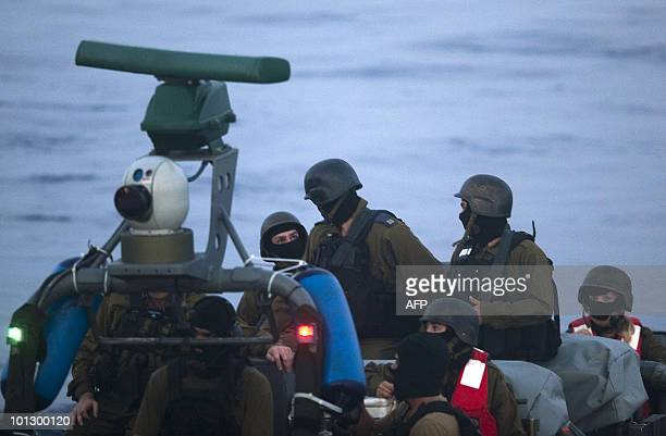 Israeli soldiers get ready to raid a ship as the Israeli navy intercepts a Gazabound aid flotilla in the Mediterranean Sea on May 31 killing several...