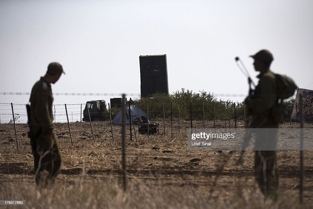 Israeli soldiers guard a radar which is part of the 'Iron Dome' short-range missile defense system on August 29, 2013 in Northern Israel. Tensions are rising in Israel amid international talks of a military intervention In Syria.