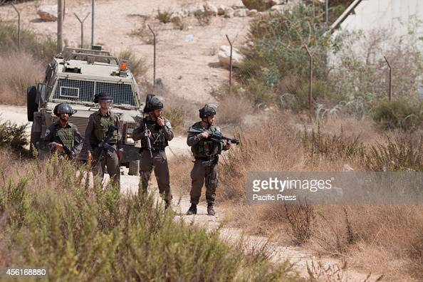 Israeli soldiers guarding the borders of an Israeli settlement during a demonstration in the village of Wadi Fukin near Bethlehem against the Israeli...