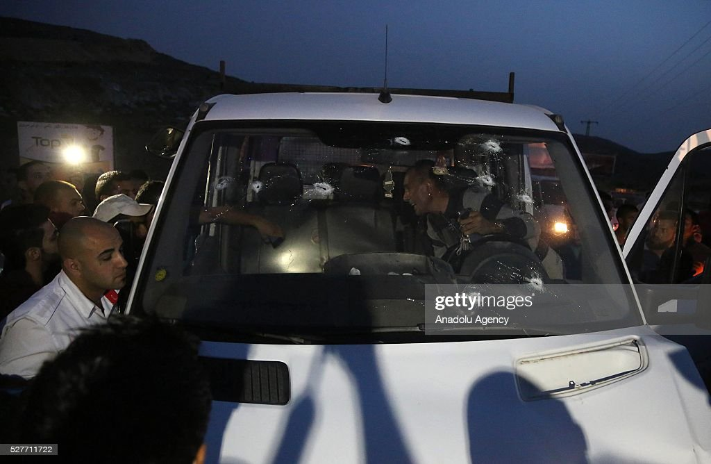 Israeli soldiers inspect crime scene after a Palestinian man who allegedly drove his car toward Israeli soldiers was shot and killed by Israeli security forces near Beitunia 17th checkpoint in Ramallah, West Bank on May 3, 2016.