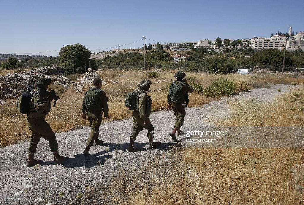 Israeli soldiers inspect the area around the Jewish settlement of Kiryat Arba where a 13-year-old Israeli girl was fatally stabbed in her bedroom on June 30, 2016 in the occupied West Bank near the Palestinian city of Hebron. A Palestinian attacker broke into the Jewish settlement in the occupied West Bank, fatally stabbing a teenage girl and wounding a security guard before being shot dead, the army said. BADER