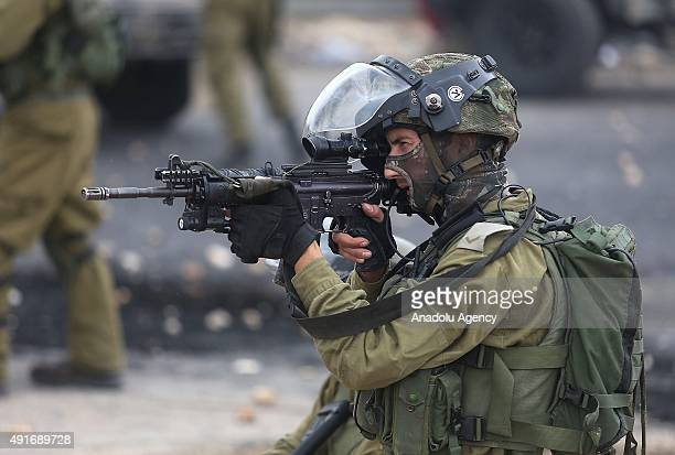 Israeli soldiers intervene protesters during a protest against preventing Palestinians from entering the AlAqsa Mosque compound on October 07 near a...