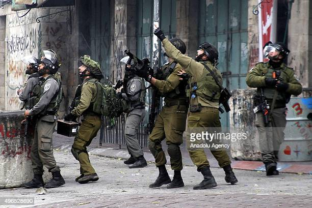 Israeli soldiers intervenes to Palestinian protesters demanding to get the bodies of people who lost their lives during the demonstrations in Hebron...