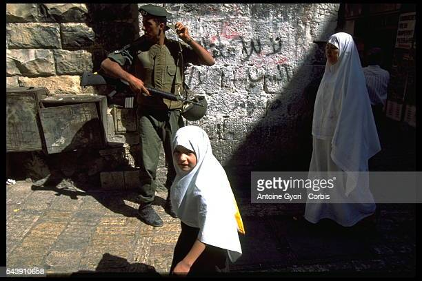 Israeli soldiers keep an eye on Palestinians in the old city of Jerusalem