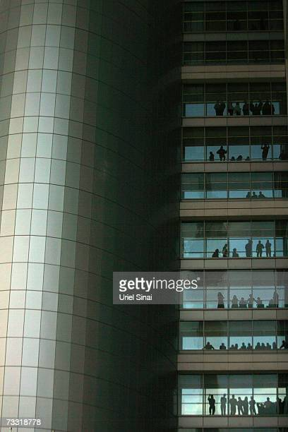 Israeli soldiers look out the window as Gabi Ashkenazi the Israel Defense Forces new chief of staff reviews an honour guard at military headquarters...