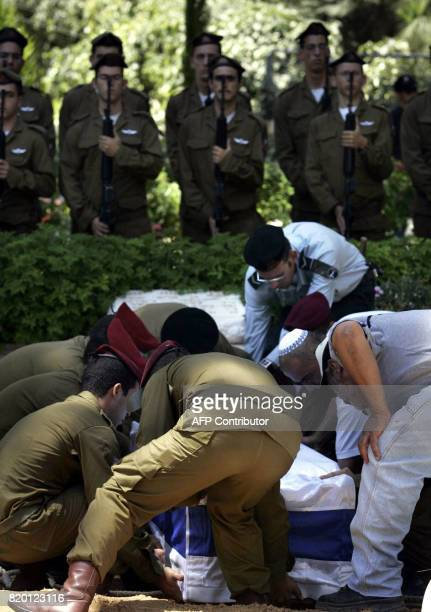 Israeli soldiers lower the coffin of Israeli soldiers Sgt Yehuda Greenfeld during his funeral at the military cemetery in Jerusalem 07 August 2006...