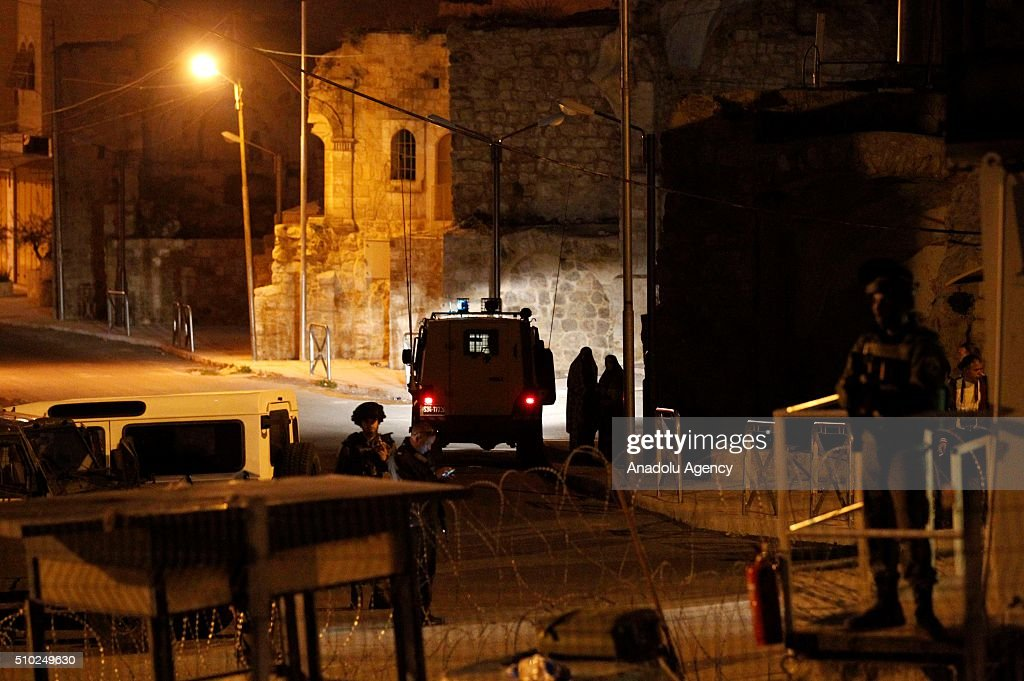 Israeli soldiers make crime scene investigation after Israeli soldiers shot a Palestinian woman in alleged knife attack, in Hebron, West Bank on February 14, 2016.