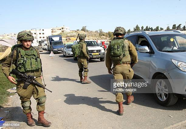 Israeli soldiers man a checkpoint at one of the entrances of the West Bank city of Hebron on November 23 2015 Israeli Prime Minister Benjamin...