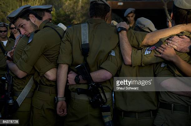 Israeli soldiers mourn during the funeral of their comrade Staff Sgt Alex Mashavisky during his funeral on January 7 2009 at the military cemetery in...