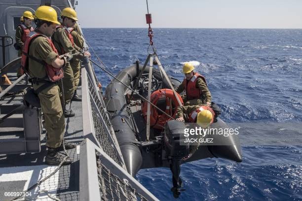 Israeli soldiers onboard the Israeli vessel Saar 5 Class Corvette 'INS Hanit' prepare an inflatable boat during the 'Novel Dina 17' exercise in the...