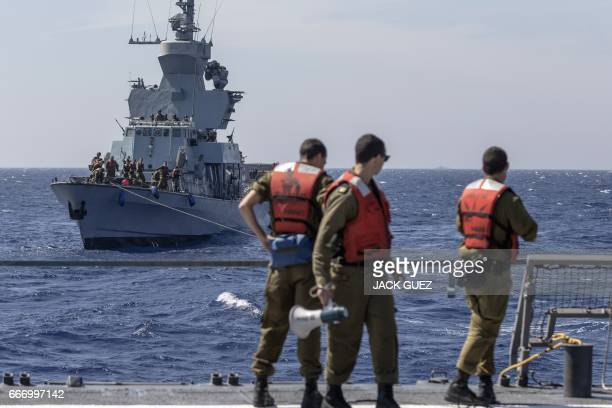 Israeli soldiers onboard the Israeli vessel Saar 5 Class Corvette 'INS Hanit' attend a training session during the 'Novel Dina 17' exercise in the...