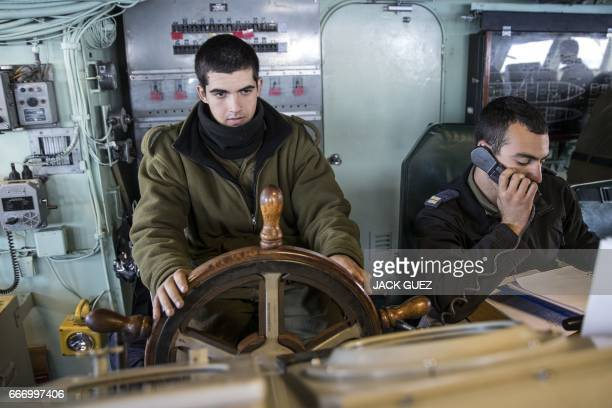 Israeli soldiers onboard the Israeli vessel Saar 5 Class Corvette 'INS Hanit' manuever the ship during the 'Novel Dina 17' training session in the...