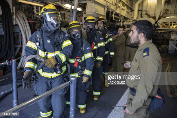 Israeli soldiers onboard the Israeli vessel Saar 5 Class Corvette 'INS Hanit' take part in a fire evacuation excercise during the 'Novel Dina 17'...