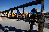 Israeli soldiers open a barrier blocking access to the alFawwar refugee camp south of the West Bank city of Hebron on July 26 2016 Israel reopened...