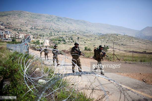 Israeli soldiers operate along Israel's border with Syria a day after ProPalestinian demonstrators stormed a ceasefire line on June 6 2011 in Israel...