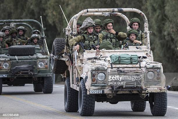 Israeli soldiers patrol along the southern Israeli border with the Gaza Strip following Israeli air strikes in the Palestinian coastal enclave before...