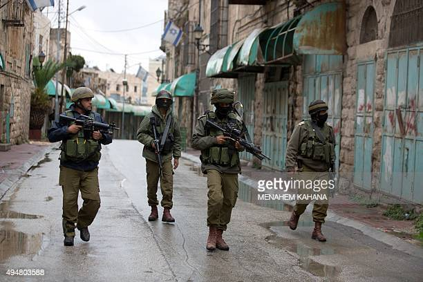 Israeli soldiers patrol near the Jewish settlement of Beit Hadassah in the Israelioccupied city of Hebron after a Palestinian youth was shot dead...