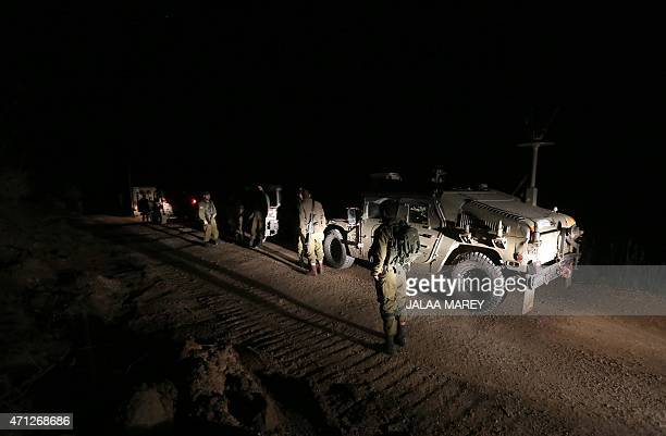 Israeli soldiers patrol on the IsraeliSyrian border near the town of Majdal Shams in the Israeli occupied Golan on April 26 after Israeli armed...
