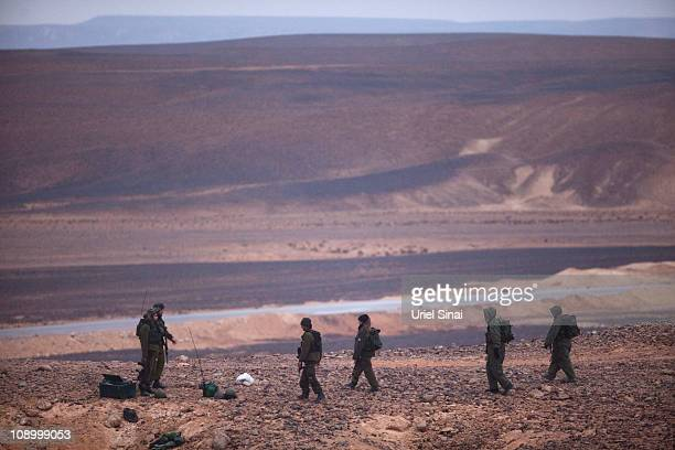 Israeli soldiers patrol the Israeli Egyptian border on February 10 201 in Israel Tensions continues to intensify during the ongoing antigovernment...