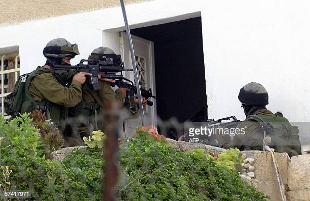 Israeli soldiers point their rifles as they break into the home of Palestinian activist Zied Mohammed Dakhlala a member of the AlAqsa Martyrs...