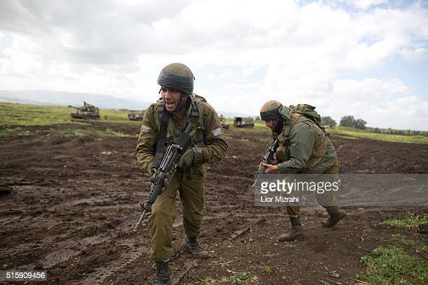 Israeli soldiers practice during an army drill on March 16 2016 in Israeliannexed Golan Heights Israeli President Reuven Rivlin landed in Moscow last...