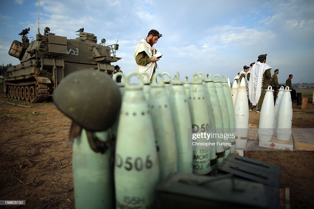 Israeli soldiers pray at dawn at an artillery emplacement on November 22, 2012 close to the northern Gaza Strip border with Israel. The ceasefire between Israel and Hamas appears to be holding despite rockets being fired on Israel from Gaza. During the night the IDF reportedly arrested a number of 'terror operatives' in the West Bank in continued efforts to restore peace in the region.