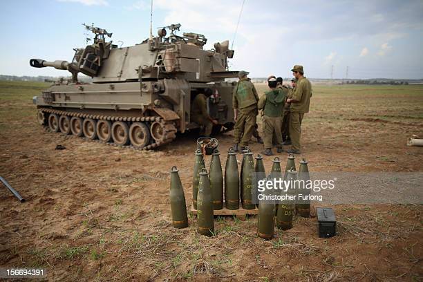 Israeli soldiers prepare an artillery emplacement overlooking Gaza on November 19 2012 on Israel's border with the Gaza Strip The death toll has...