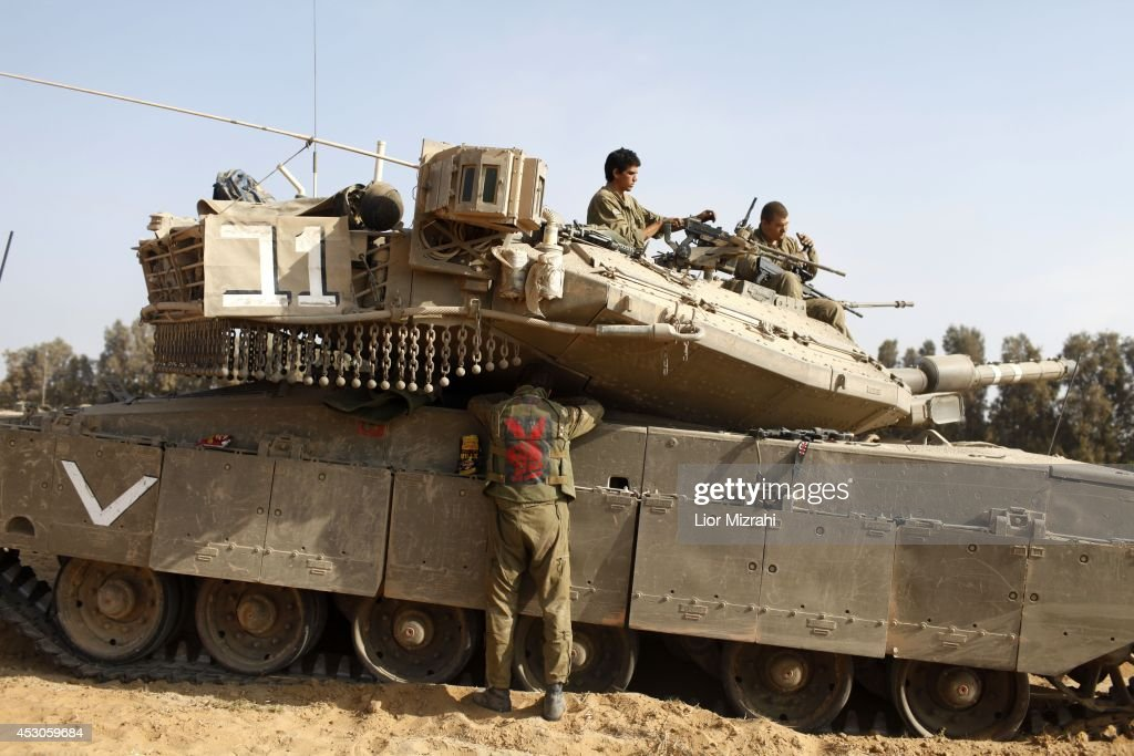 Israeli soldiers prepare their tanks in a deployment area on August 02, 2014 on Israel's border with the Gaza Strip. The Israeli military on Friday cited indications that the officer, Second Lt. Hadar Goldin, 23, was taken captive in Rafah, a city in the Gaza Strip's south. Two other soldiers were killed in the attack, raising the number of Israeli military fatalities to 63. The announcement came not long after a 72-hour humanitarian cease-fire agreed upon by Israel and Hamas collapsed within two hours of being launched.