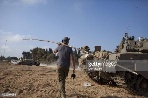 Israeli soldiers prepare their Tanks in a deployment area on July 24 2014 on Israel's border with the Gaza Strip Washington's top diplomat said...