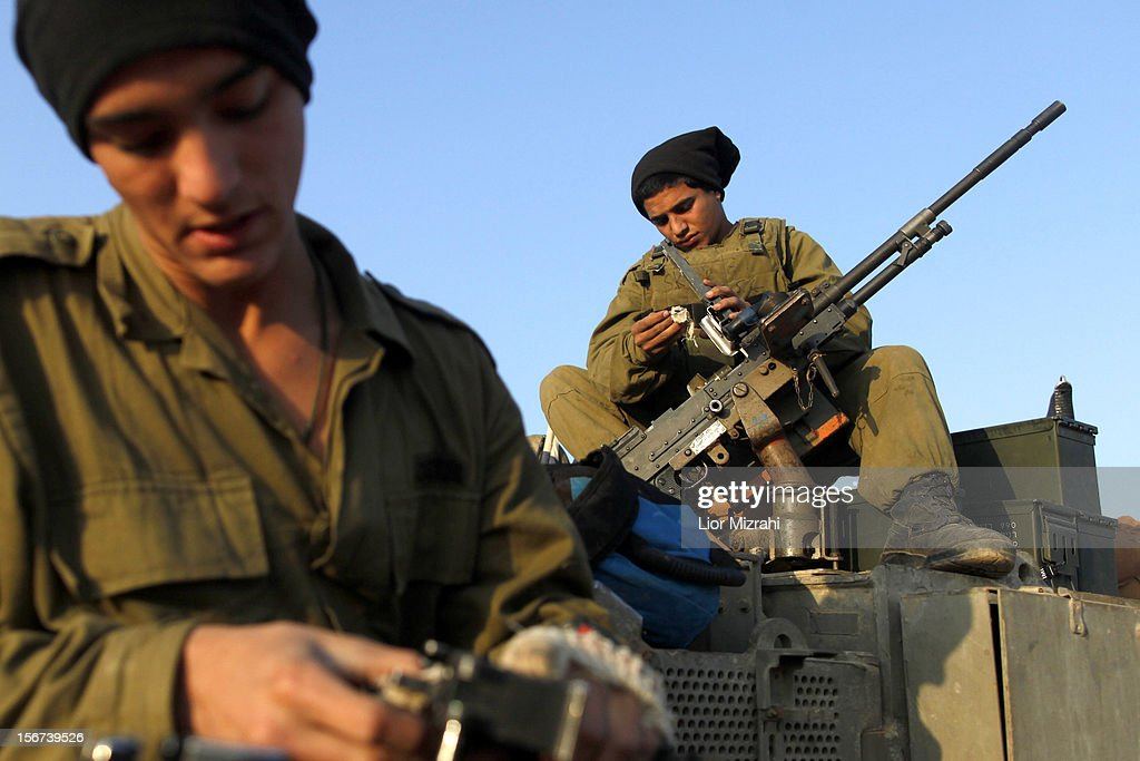 Israeli soldiers prepare their weapons in a deployment area as the conflict between Palestine and Gaza enters its seventh day on November 20 2012 on...