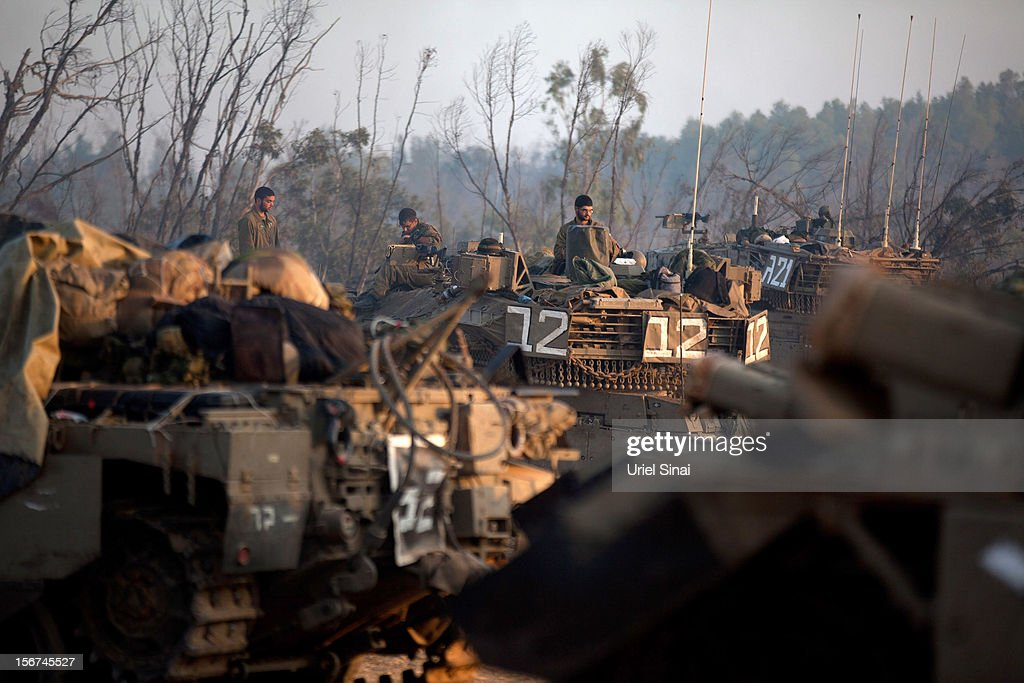 Israeli soldiers prepare weapons and vehicles in a deployment area as the conflict between Palestine and Gaza enters its seventh day on November 20...