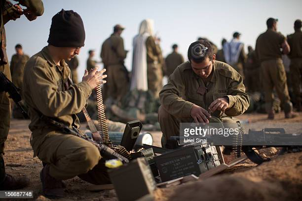 Israeli soldiers prepare weapons in a deployment area on November 19 2012 on Israel's border with the Gaza Strip The death toll has risen to at least...