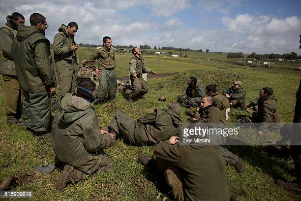 Israeli soldiers receive a briefing during an army drill on March 16 2016 in Israeliannexed Golan Heights Israeli President Reuven Rivlin landed in...