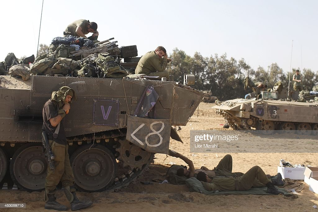 Israeli soldiers rest in a deployment area on August 02, 2014 on Israel's border with the Gaza Strip. The Israeli military on Friday cited indications that the officer, Second Lt. Hadar Goldin, 23, was taken captive in Rafah, a city in the Gaza Strip's south. Two other soldiers were killed in the attack, raising the number of Israeli military fatalities to 63. The announcement came not long after a 72-hour humanitarian cease-fire agreed upon by Israel and Hamas collapsed within two hours of being launched.