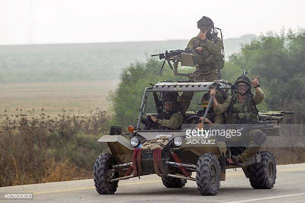 Israeli soldiers ride on a quad along the southern Israeli border with the Gaza Strip on July 24 2014 US Secretary of State John Kerry spoke today to...