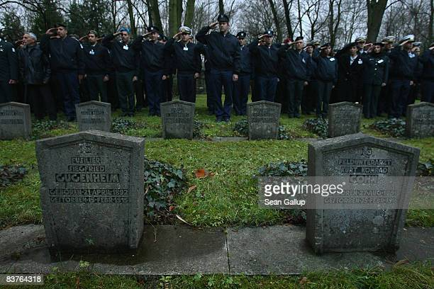 Israeli soldiers stand at attention over graves of German Jewish soldiers who died fighting for Germany during World War I while visiting the...