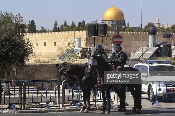 Israeli soldiers stand guard as Palestinian worshippers perform Friday prayer on a street near the AlAqsa Mosque Compound as Israeli authorities...