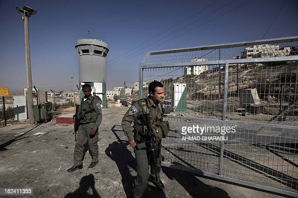 Israeli soldiers stand guard at Ras Khamis checkpoint in east Jerusalem on September 20 2012 where is a key checkpoint allowing Palestinians from...
