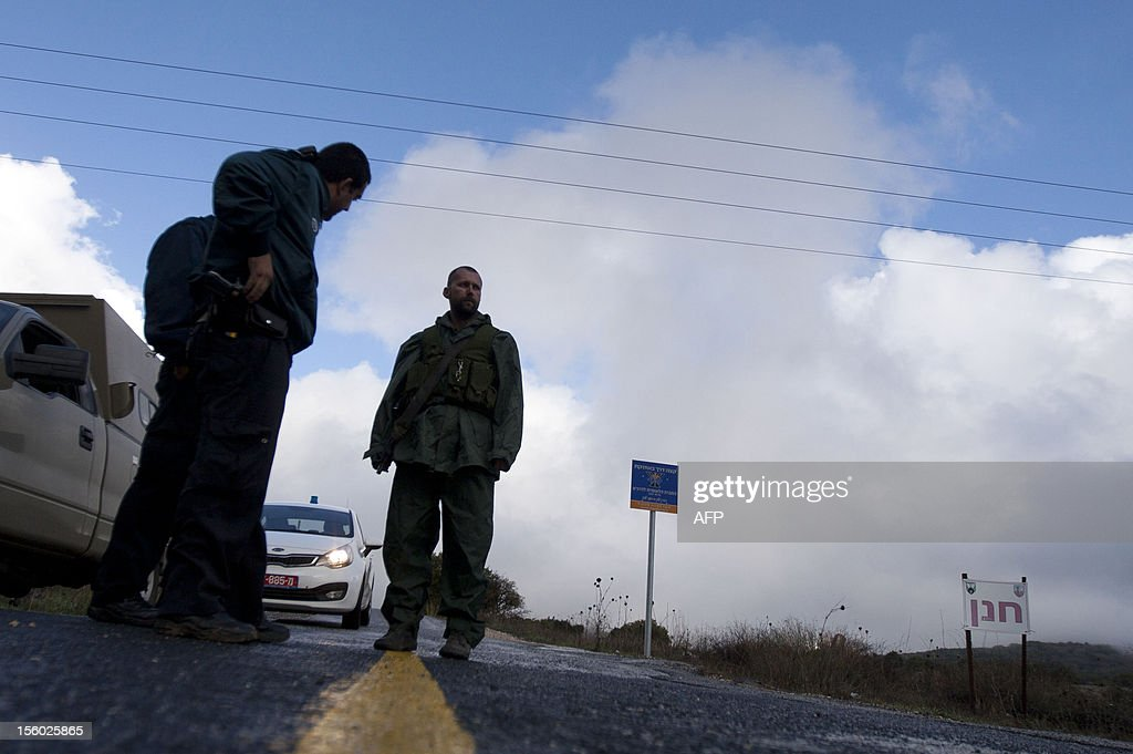 Israeli soldiers stand guard in Alonei Habashan in the Israeli-occupied Golan Heights, on November 11, 2012. Israeli troops fired warning shots into Syria in response to mortar fire, the army said, in the first Israeli fire directed at the Syrian military in the Golan Heights area since the 1973 war.