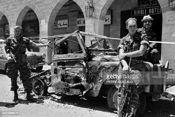 Israeli soldiers stand near a destroyed jeep in front of Rivoli hotel in Salah eDin Street in Jerusalem in June 1967 during the sixday war On 05 June...