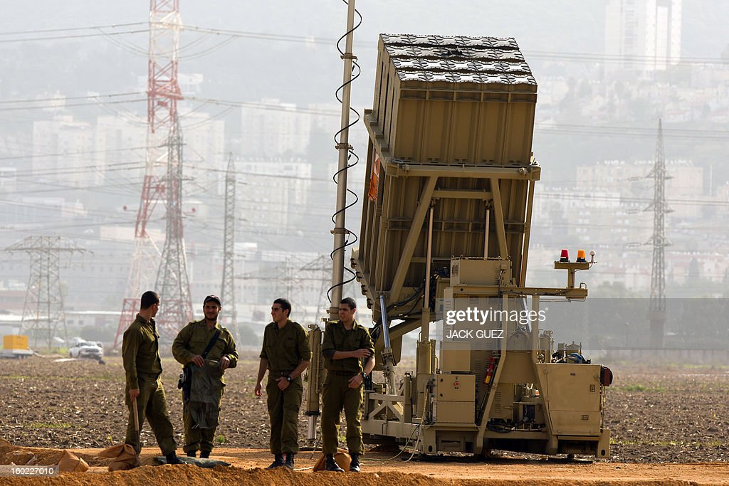 Israeli soldiers stand next to an 'Iron Dome' short-range missile defence system near the northern Israeli city of Haifa on January 28, 2013. The Iron Dome defence missile system is designed to intercept and destroy incoming short-range rockets and artillery shells. Fearing that Syrian chemical weapons could fall into the hands of Islamist militants, Israel is taking diplomatic and military steps to prevent it, local media and a security source said.