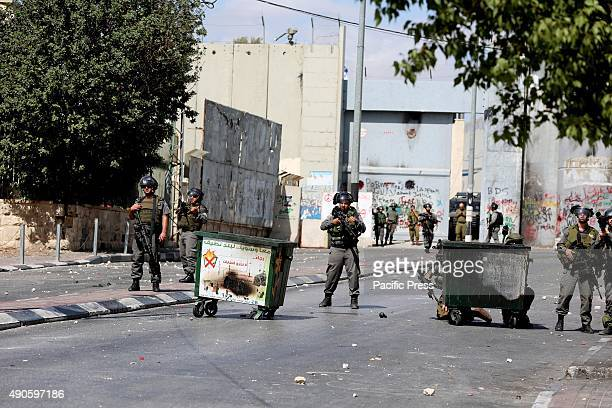 Israeli soldiers station themselves inside the West Bank city of Bethlehem right outside the Israeli military checkpoint checkpoint 300 Israeli...