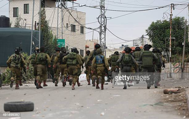 Israeli soldiers storm the West Bank town of Beit Ummar during clashes there with Palestinian youth Israeli soldiers stormed the West Bank town of...