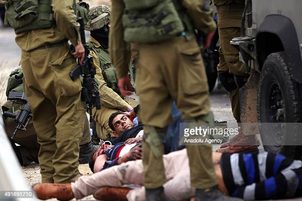 Israeli soldiers take Palestinians into custody during a protest against preventing Palestinians from entering the AlAqsa Mosque compound on October...