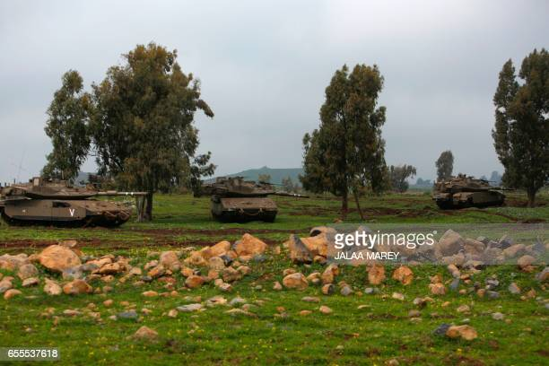 Israeli soldiers take part in a military training in the Israeliannexed Golan Heights near the IsraelSyria border on March 20 2017 / AFP PHOTO /...