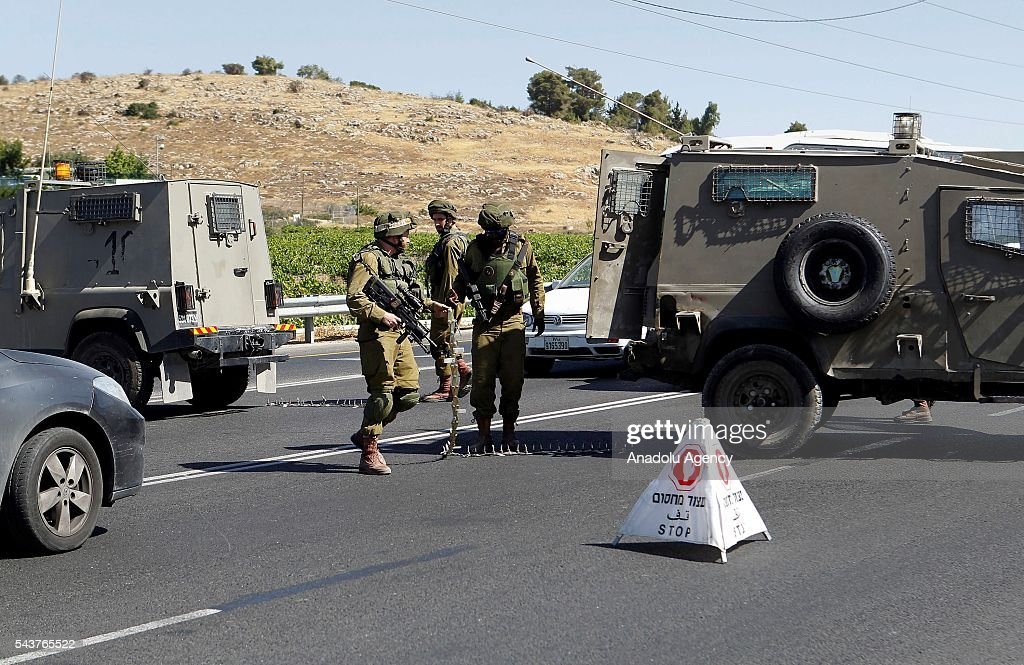 Israeli soldiers take security measures after a Palestinian, who allegedly attempted a stabbing attack, shot dead by Israeli soldiers in Kiryat Arba town, West Bank on June 30, 2016.