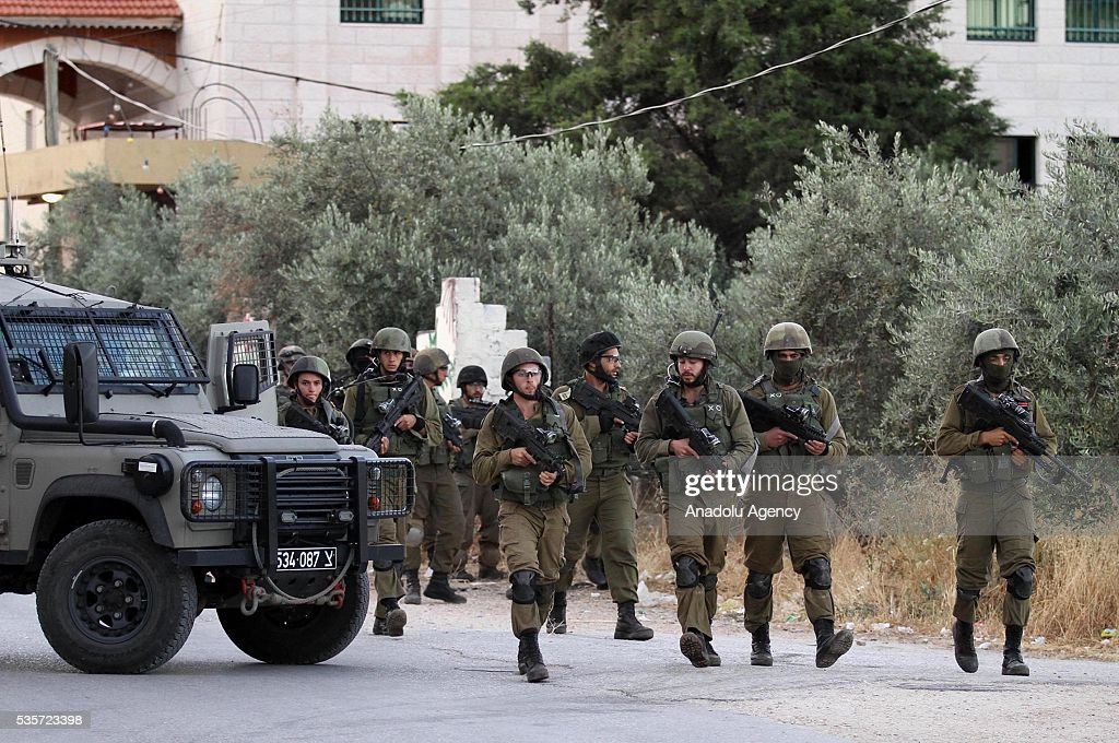 Israeli soldiers take security measures as they storm over some Palestinians' houses in Nablus, West Bank on May 30, 2016.